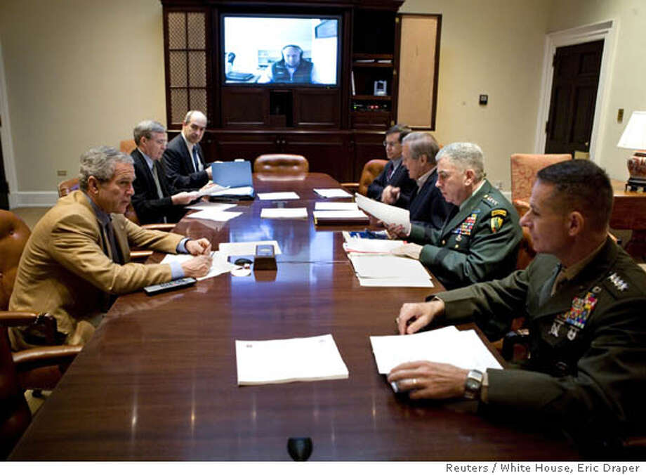 "U.S. President George W. Bush (L) speaks during a video teleconference with Vice President Dick Cheney (on screen) and military commanders in the Roosevelt Room of the White House in Washington October 21, 2006. Bush said on Saturday he would make ""every necessary change"" in tactics to respond to spiraling violence in Iraq, and he acknowledged a drive to stabilize Baghdad had not gone as planned. Pictured from second left, are: National Security Advisor Stephen Hadley, Deputy National Security Advisor J.D. Crouch, Senior Advisor to the Secretary of State on Iraq David Satterfield, Secretary of Defense Donald Rumsfeld, U.S. Army General John Abizaid and Chairman Joint Chiefs of Staff, U.S. Marine Gen. Peter Pace. FOR EDITORIAL USE ONLY REUTERS/Eric Draper/White House/Handout (UNITED STATES) Photo: HO"