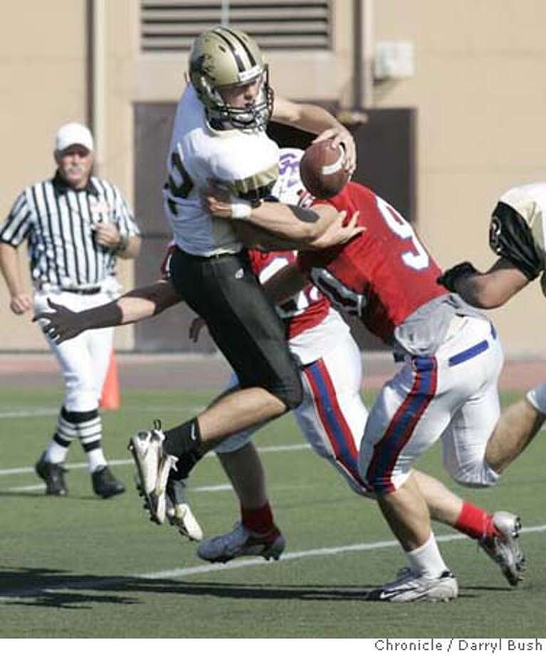 preps22_0005_db.JPG  Mitty's quarterback Jordan Esparza is sacked by St. Ignatius Chris Blohm (90) in the 4th qtr. as St. Ignatius defeats Archbishop Mitty (high schools) at St. Ignatius in San Francisco, CA, on Saturday, October 21, 2006. 10/21/06  Darryl Bush / The Chronicle ** roster (cq) Ran on: 10-22-2006  Mitty QB Jordan Esparza is sacked by Chris Blohm of St. Ignatius. Photo: Darryl Bush