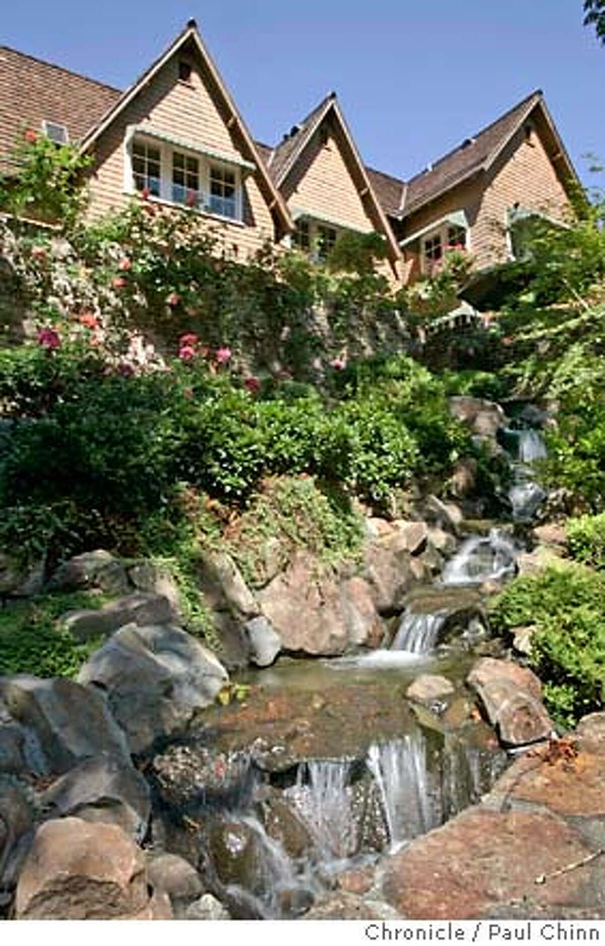 A waterfall cascades down the hill at an estate on three acres with a total of 11 bedrooms and nine-and-a-half baths in Ross, Calif. on Saturday, September 16, 2006. Originally built in 1896, the 6,000 square foot property is on the market for $22 million and features a tennis court, swimming pool and enormous six car garage. PAUL CHINN/The Chronicle MANDATORY CREDIT FOR PHOTOGRAPHER AND S.F. CHRONICLE/ - MAGS OUT
