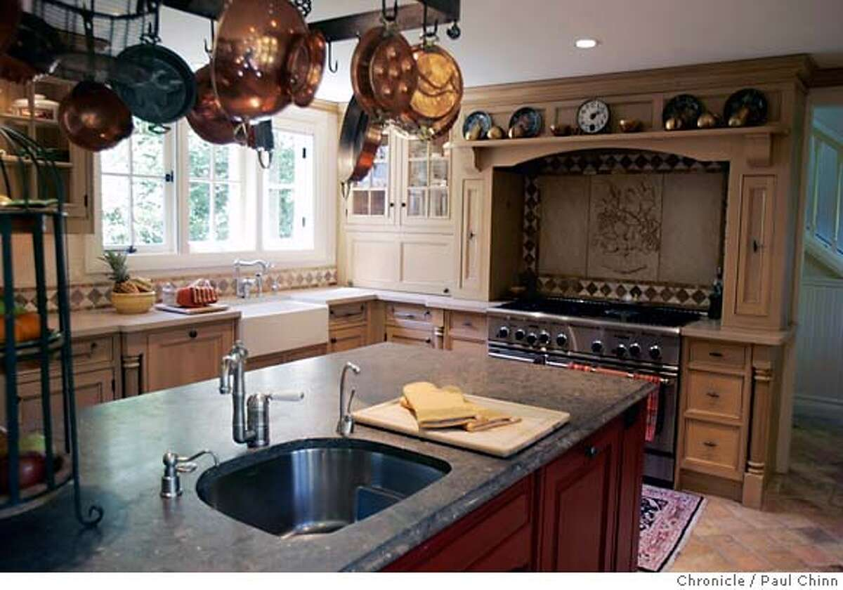 The kitchen of an estate on three acres with a total of 11 bedrooms and nine-and-a-half baths in Ross, Calif. on Saturday, September 16, 2006. Originally built in 1896, the 6,000 square foot property is on the market for $22 million and features a tennis court, swimming pool and enormous six car garage. PAUL CHINN/The Chronicle MANDATORY CREDIT FOR PHOTOGRAPHER AND S.F. CHRONICLE/ - MAGS OUT