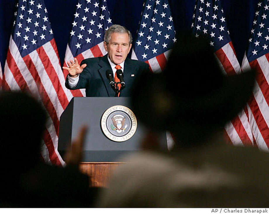 Audience members applaud as President Bush speaks at a National Republican Senatorial Committee Reception, a fund raising event, in Washington, Friday, Oct. 20, 2006. (AP Photo/Charles Dharapak) Photo: CHARLES DHARAPAK