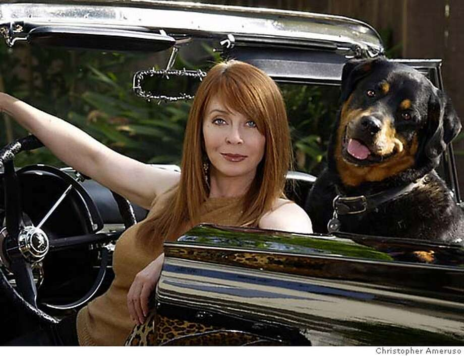 Cassandra Peterson, better known as horror hostess Elvira, with her dog, Mina. Peterson is an animal rights activist. Photo by Christopher Ameruso