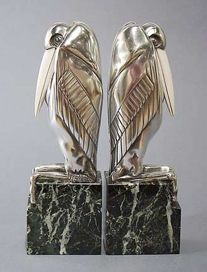 These Malibu Stork bookends were formed in Art Deco style by French sculptor Marcel Bouraine. They are silvered bronze and ivory with marble plinths.