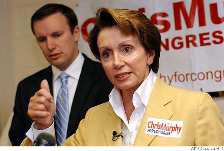 U.S. Rep. Nancy Pelosi, D-Calif., right, joins Democratic congressional candidate Chris Murphy at a news conference on reforming Medicare Part D in Waterbury, Conn., Thursday, Aug. 24, 2006. (AP Photo/Jessica Hill)  Ran on: 09-04-2006  Volunteer Svetlana Kaff (left), an immigration lawyer, helps Laura Guarino with legal questions.  Ran on: 09-04-2006 Photo: JESSICA HILL