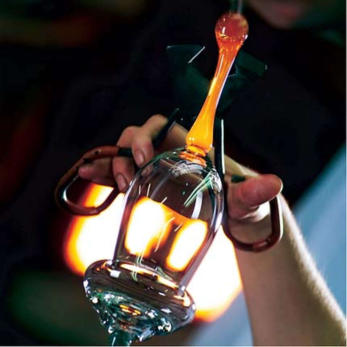 Liquid glass is cut and pulled to form the stem of a Riedel crystal wineglass.