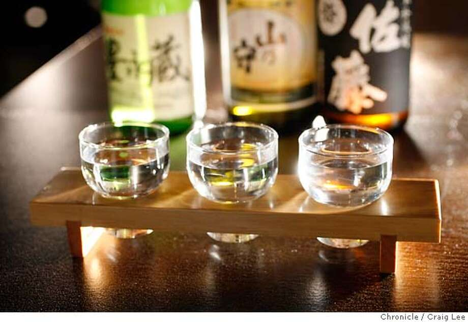 .JPG  Photo of the Shochu sampler at a restaurant called Poleng Lounge. They serve a Shochu sampler of three small glasses in a wooden holder. Left-right with the bottles behind them: 1. Toyonga, Landmark of Plenty, 2. Yama No Mori Shochu, 3. Satoh Shochu.  Craig Lee / The Chronicle MANDATORY CREDIT FOR PHOTOG AND SF CHRONICLE/ -MAGS OUT Photo: Craig Lee