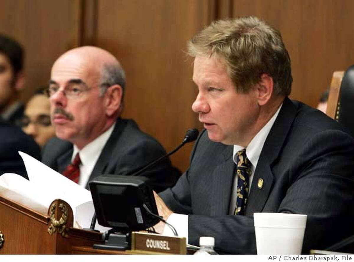 Rep. Tom Davis, R-Va., chairman of the House Committee on Government Reform, right, speaks as ranking minority member Rep. Henry Waxman, D-Calif., left, looks on during a hearing regarding the NFL's steroid policy on Capitol Hill Wednesday, April 27, 2005. The NFL's steroids policy is tough,