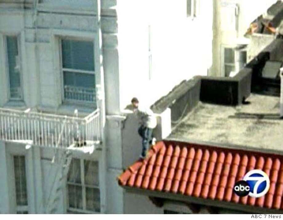 A frame grab from KGO TV shows a still photograph of Nick Torrico climbing on the facade of 900 Powell St., moments before he fell to his death after a rescue attempt by San Francisco firefighter Victor Wyrsch. CREDIT: KGO TV Photo: KGO TV