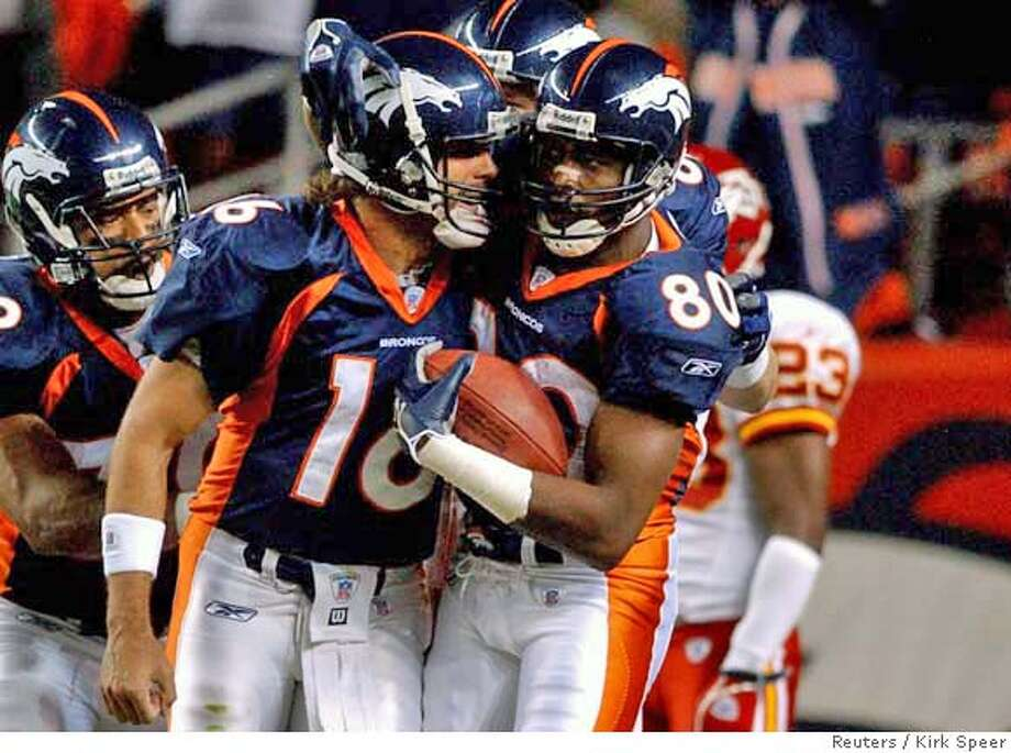 Denver Broncos quarterback Jake Plummer (L) congratulates wide receiver Rod Smith (R) after Smith's 10-yard touchdown reception during Monday nights game at Invesco Stadium at Mile High September 26, 2005. REUTERS/Kirk Speer Ran on: 09-27-2005 0 Photo: STRINGER/USA