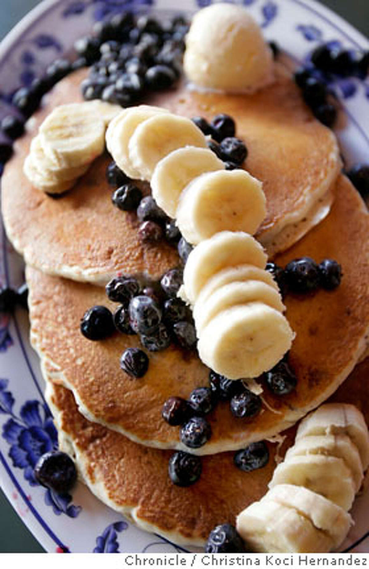 Full stack of pancakes with bananas and blueberries. Pork Store Cafe is the Bargain Bite to run in 96 Hours October 19.This is a good ol' American breakfast spot: If possible, try to go in the morning or on a weekend to get the feel of the crowd. Food-wise, a shot of something like the Santa Fe scramble or a stack of blueberry pancakes or a waffle with butter and syrup would do the trick. .(CHRISTINA KOCI HERNANDEZ/THE CHRONICLE)