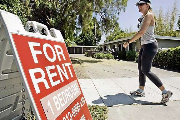 """** EMBARGOED FOR USE UNTIL 12:01 A.M. PDT Thursday, July 20 **A woman walks next to a """"For Rent"""" sign at an apartment complex in Palo Alto Calif., Wednesday, July 19, 2006. Apartment occupancy rates rose across most of the West's major markets in the second quarter, driving rents higher compared to the same period last year, according to a report released Thursday, July 20, 2006. (AP Photo/Paul Sakuma)  Ran on: 07-20-2006  A woman walks past a rental sign at an apartment complex in Palo Alto. Santa Clara County rental prices have risen 9 percent. ** EMBARGOED FOR USE UNTIL 12:01 A.M. PDT THURSDAY, JULY 20 **"""