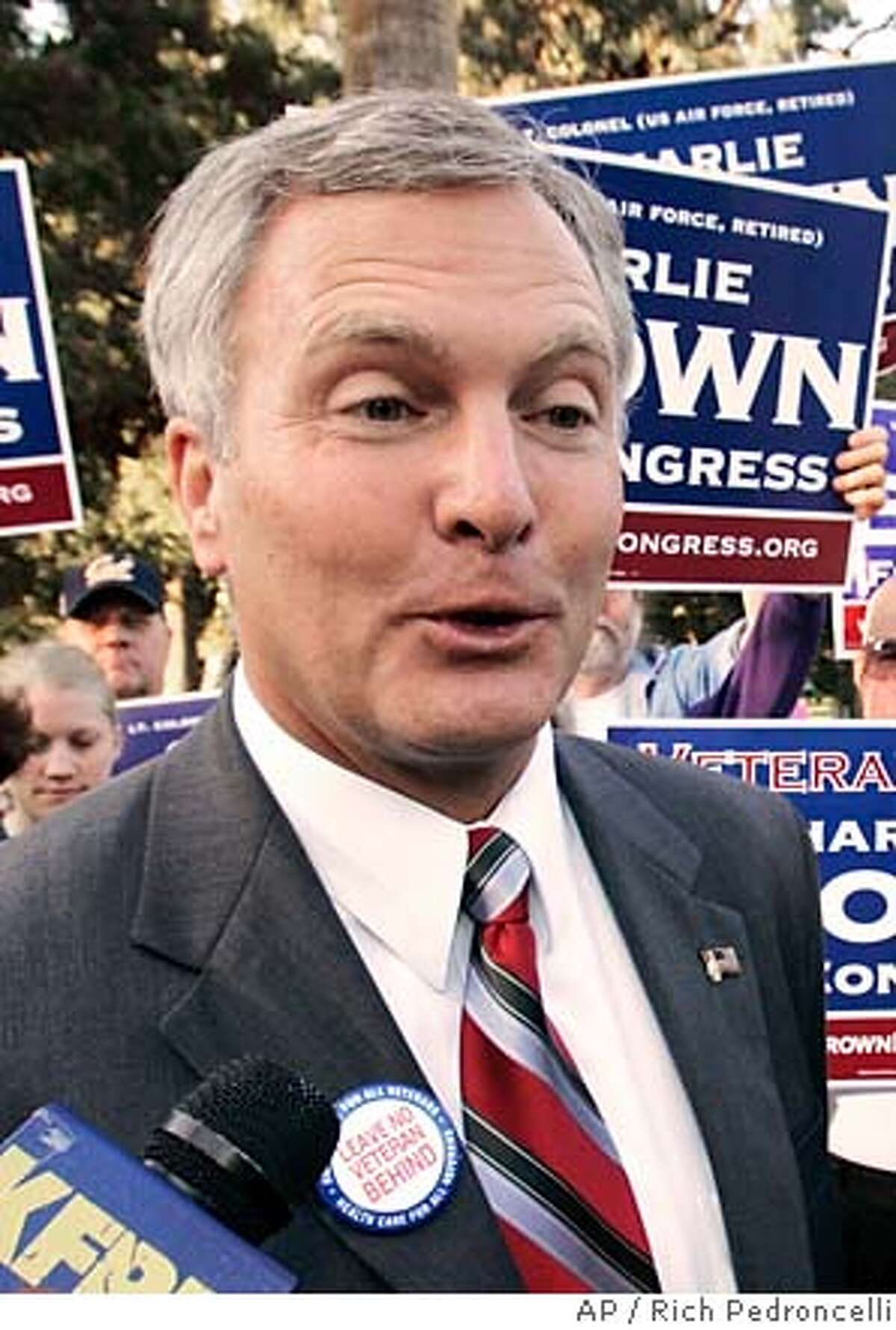 Democratic Congressional candidate Charlie Brown, left, talks to reporters after appearing with retired Army Gen. Wesley Clark, right, at the Vietnam Veterans Memorial in Sacramento, Calif., Monday, Oct. 2, 2006. Clark attended the event to show his support for Brown, a retired Air Force Lt. Col. who is running against eight-term incumbent Republican, John Doolittle.(AP Photo/Rich Pedroncelli)