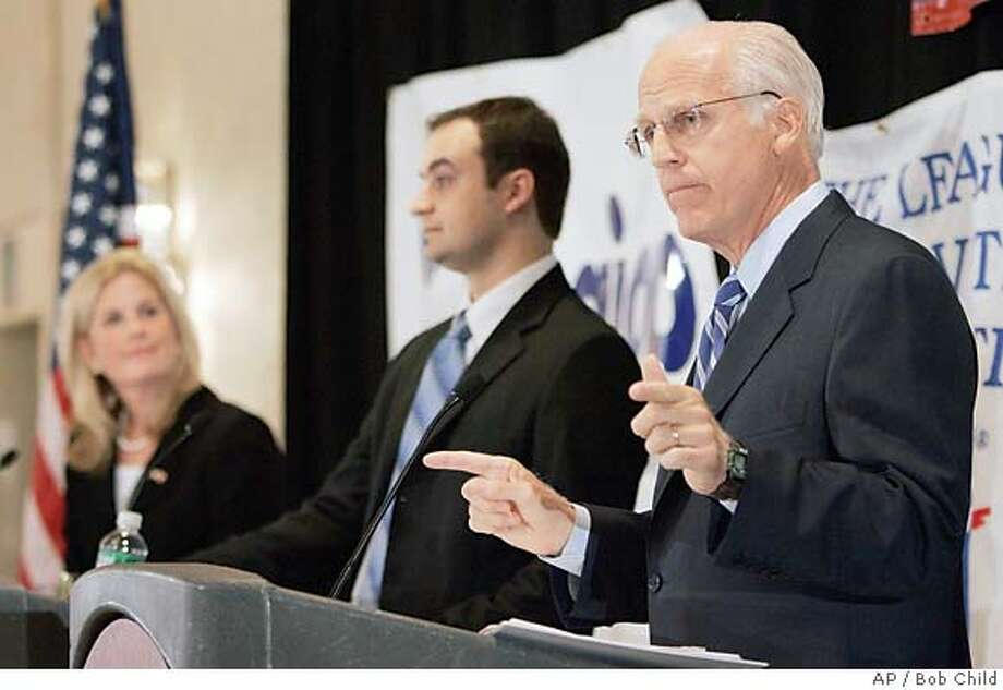 Incumbent Republican U.S. Rep. Christopher Shays, right, talks during a three-way debate with Democratic challenger Diane Farrell, left, and Libertarian Party challenger Phil Maymin in Stamford, Conn., Wednesday, Oct. 4, 2006. During the debate Shays called for the resignation of U.S. Secretary of Defense Donald Rumsfeld. (AP Photo/Bob Child) Photo: BOB CHILD