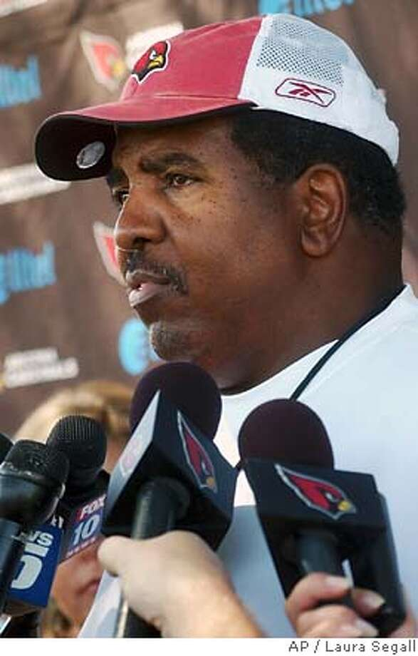 Arizona Cardinals coach Dennis Green talks with reporters after football practice Wednesday, Oct. 11, 2006, at the team's training facility in Tempe, Ariz. The 1-5 Cardinals will host the undefeated Chicago Bears Monday night. (AP Photo/Laura Segall) EFE OUT Photo: LAURA SEGALL
