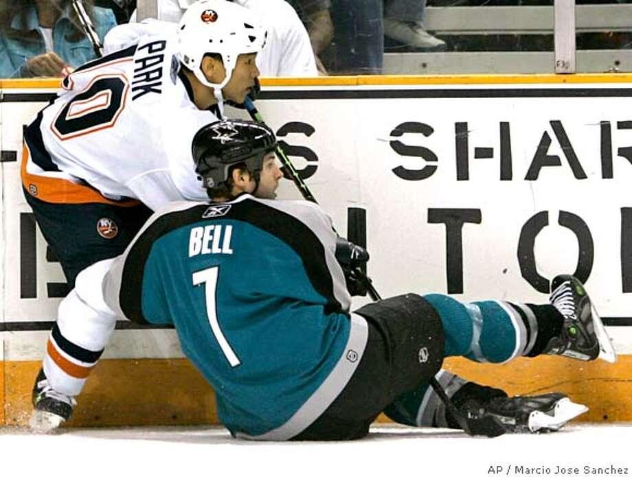 New York Islanders' Richard Park (10) checks San Jose Sharks' Mark Bell in the first period of a hockey game Saturday, Oct. 7, 2006, in San Jose, Calif. (AP Photo/Ben Margot) Photo: BEN MARGOT