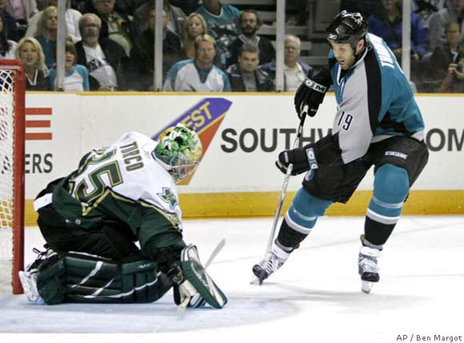 San Jose Sharks' Joe Thornton, right, has his shot blocked by Dallas Stars goaltender Marty Turco in the second period of a NHL hockey game in San Jose, Calif., Tuesday, Oct. 17, 2006.(AP Photo/Marcio Jose Sanchez) Photo: MARCIO JOSE SANCHEZ