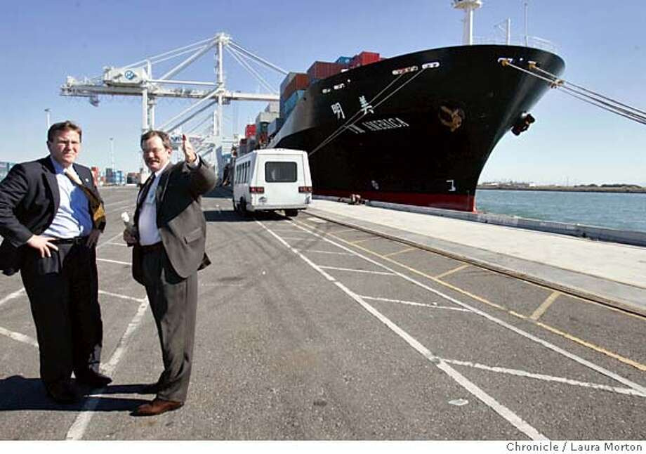 Gerald Serventi (right), Port of Oakland Director of Engineering, gives a tour to Sean Connaughton, the United States Department of Transportation Maritime Administration's Administrator, at the port on Tuesday afternoon. Photo: Laura Morton