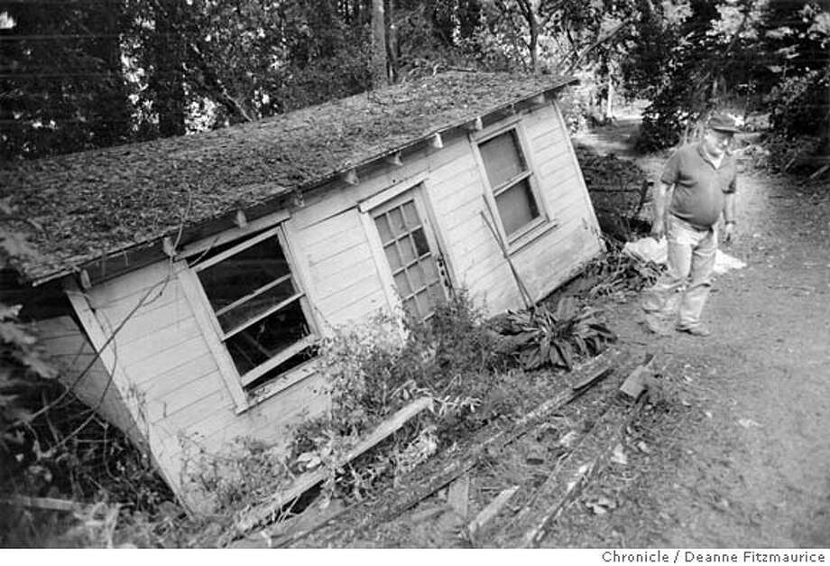 EARTHQUAKE/18OCT89/MN/DF - EARTHQUAKE1/B/30SEP99/SC/FILE--Jay Veitenheimer walks away from his storage house which slid down a hillside in the Santa Cruz mountains along San Jose-Soquel Road on October 18, 1989. CHRONICLE PHOTO BY DEANNE FITZMAURICE. 7.1 Loma Prieta Earthquake that rocked San Francisco. Photo: Deanne Fitzmaurice