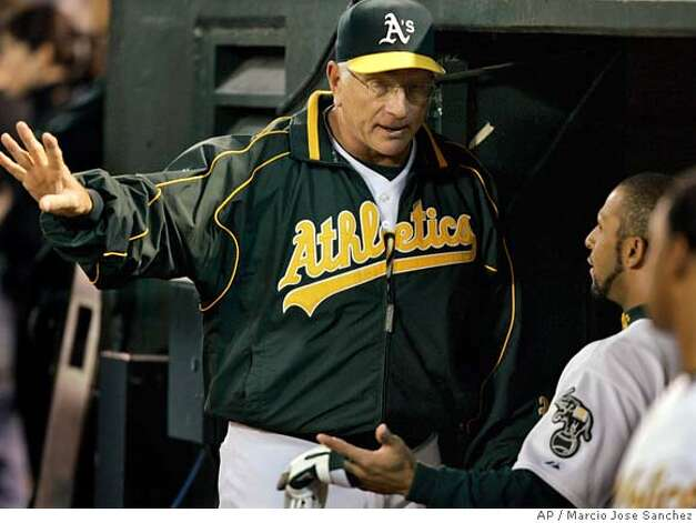 Oakland Athletics' manager Ken Macha speaks with Jay Payton after Payton hit an RBI ground out in the eighth inning against the Detroit Tigers in Game 1 of the American League Championship Series in Oakland, Calif., Tuesday, Oct. 10, 2006. The Tigers defeated the Athletics 5-1. (AP Photo/Marcio Jose Sanchez) Photo: Marcio Jose Sanchez
