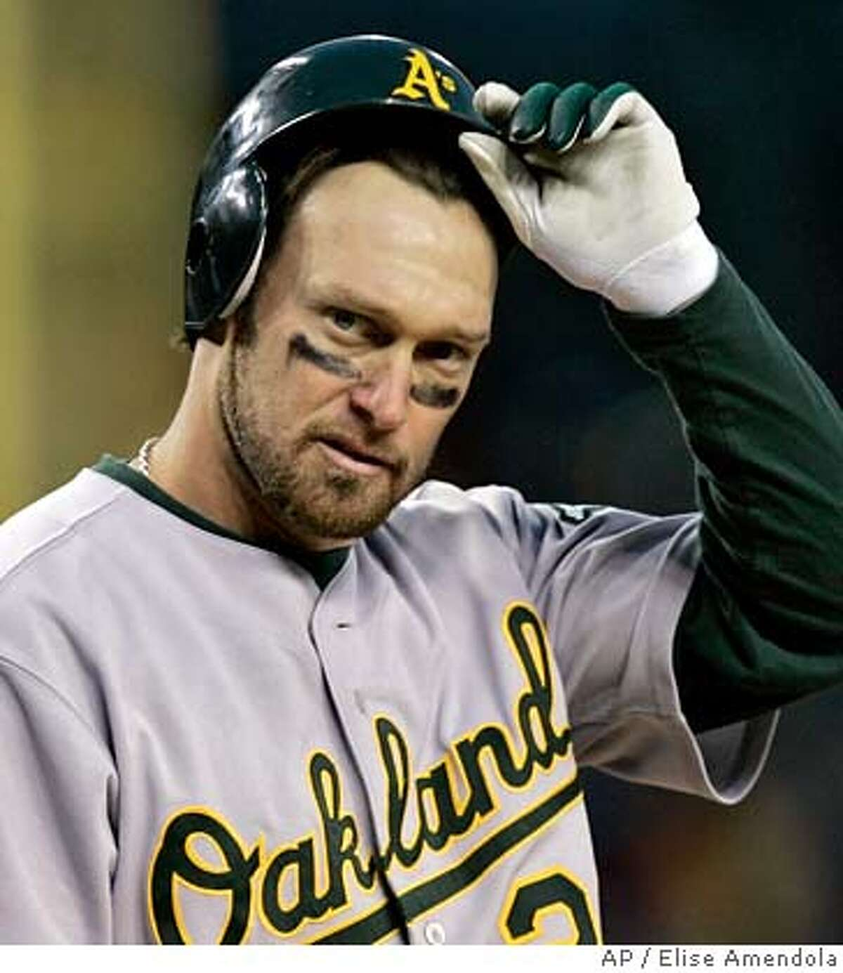 Oakland Athletics' Mark Kotsay takes off his helmet after striking out in the seventh inning leaving one man on in Game 4 of the American League Championship Series in Detroit, Saturday, Oct. 14, 2006. (AP Photo/Elise Amendola)