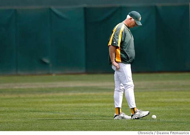 athletics_0423_df.jpg  Ken Macha, Oakland Athletics manager, helps round up baseballs from the field after practice. The Oakland Athletics and the Minnesota Twins practiced today on the off day before game three Friday in the Division Series. Event in Oakland on 10/5/06.  (Deanne Fitzmaurice/ The Chronicle) Mandatory credit for photographer and San Francisco Chronicle. /Magazines out. Photo: Deanne Fitzmaurice