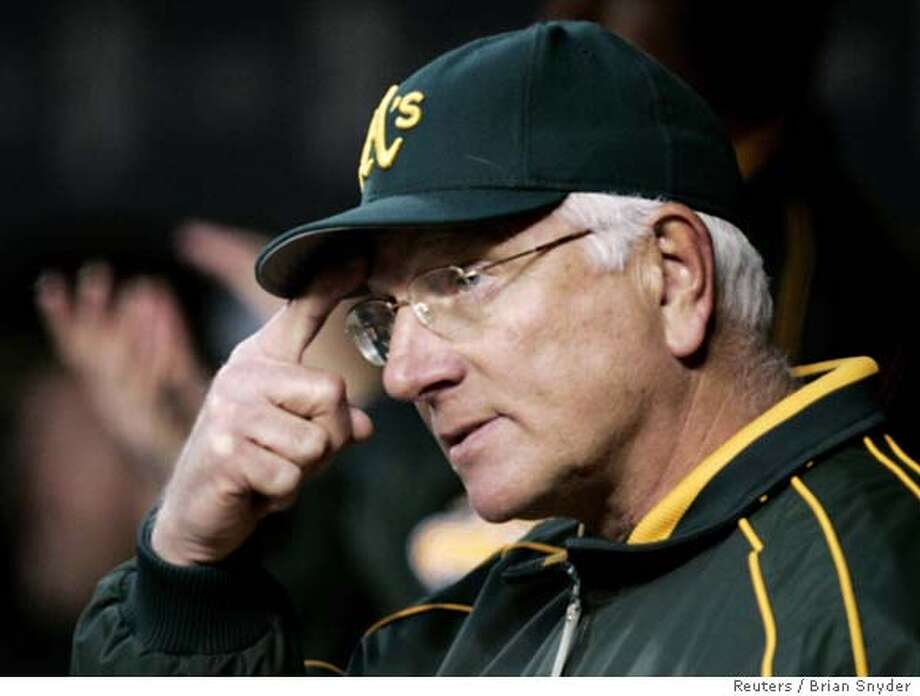 Oakland Athletics manager Ken Macha watches from the dugout in the eighth inning during Game 3 of their ALCS playoff baseball series against Detroit Tigers in Detroit October 13, 2006. REUTERS/Brian Snyder (UNITED STATES) 0 Photo: BRIAN SNYDER