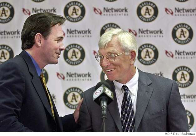 ** FILE **Oakland Athletics general manager Billy , left, congratulates new A's manager Ken Macha during a news conference in Oakland, Calif., Oct. 29, 2002. A Boston Red Sox spokesman confirmed Saturday night, Nov. 9, that the A's have given them permission to talk to about the same job with the Red Sox. (AP Photo/Paul Sakuma, File) ALSO RAN 6/17/03 Photo: PAUL SAKUMA