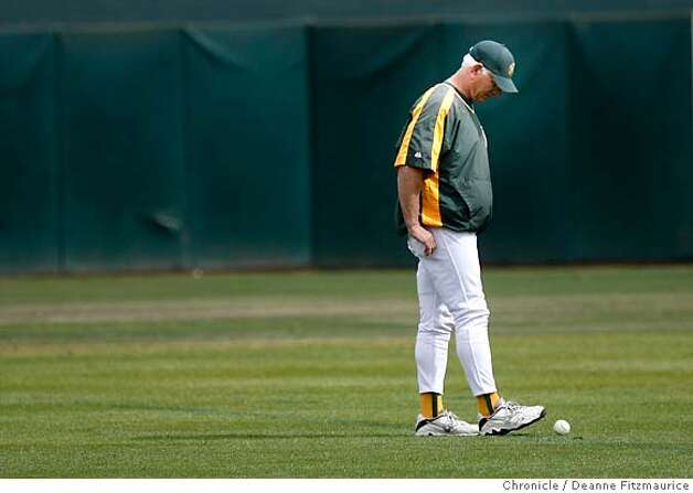 athletics_0423_df.jpg  Ken Macha, Oakland Athletics manager, helps round up baseballs from the field after practice. The Oakland Athletics and the Minnesota Twins practiced today on the off day before game three Friday in the Division Series. Event in Oakland on 10/5/06.  (Deanne Fitzmaurice/ The Chronicle) Ran on: 10-10-2006  Ken Macha overcame a terrible start, injuries to key personnel and &quo;a thousand-pound gorilla&quo; to lead the A's to the ALCS -- a first for Oakland since the days when Tony La Russa ran the show.  Ran on: 10-10-2006  Ken Macha overcame a terrible start, injuries to key personnel and &quo;a thousand-pound gorilla&quo; to lead the A's to the ALCS -- a first for Oakland since the days when Tony La Russa ran the show. Photo: Deanne Fitzmaurice