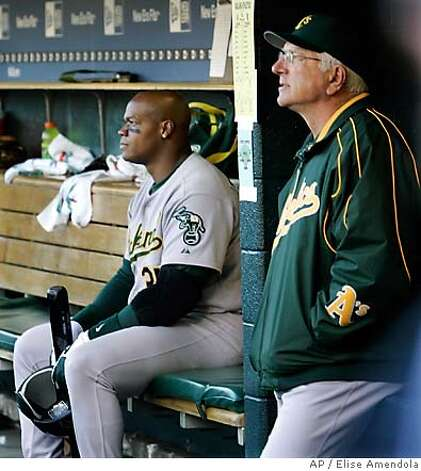 Oakland Athletics' manager Ken Macha, right and Frank Thomas watch the game from the dugout during Game 4 of the American League Championship Series against the Detroit Tigers in Detroit, Saturday, Oct. 14, 2006. Thomas is hitless in twelve at bats during the series. (AP Photo/Elise Amendola) Photo: Elise Amendola