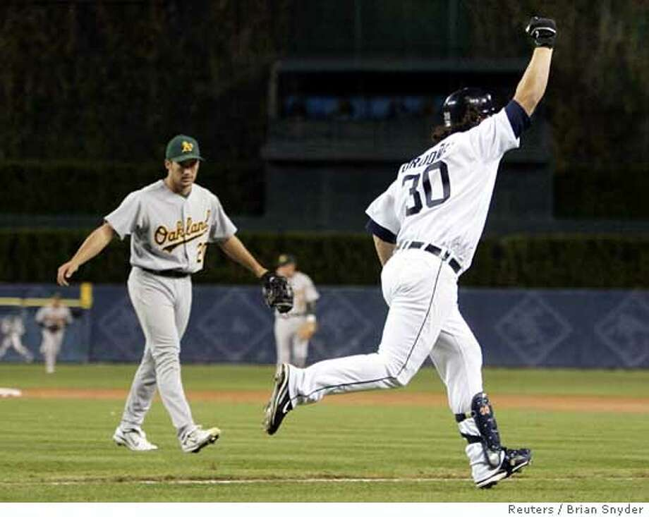 Detroit Tigers Magglio Ordonez (R) rounds the bases past Oakland Athletics pitcher Huston Street after Ordonez hit a game-winning and series clinching home run in the ninth inning during Game 4 of their ALCS playoff baseball series in Detroit October 14, 2006. REUTERS/Brian Snyder (UNITED STATES)  Ran on: 10-16-2006  Huston Street is one of the A's who would like to see Magglio Ordo�ez and the Tigers go all the way.  Ran on: 10-16-2006  Huston Street is one of the A's who would like to see Magglio Ordo�ez and the Tigers go all the way. Photo: BRIAN SNYDER