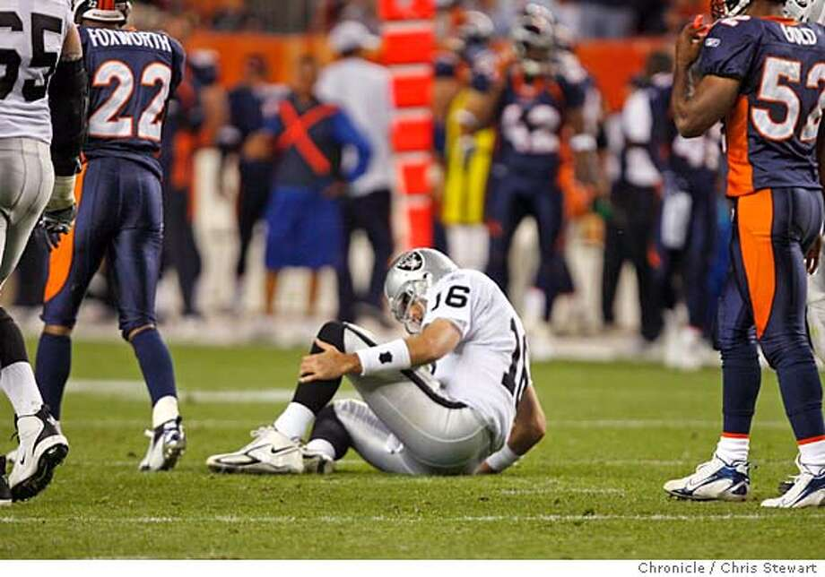 raiders_292_cs.jpg  Raiders QB Andrew Walter sits on the ground after being hit hard on a failed third down pass play at the end of the third quarter. The Raiders were forced to punt. The now 0-5 Oakland Raiders lost to the 4-1 Denver Broncos 13-3, Sunday, October 15, 2006 at Invesco Field at Mile High in Denver, Colorado. Chris Stewart / The Chronicle Oakland Raiders, Denver Broncos Ran on: 10-16-2006  Quarterback Andrew Walter is down after another hard hit following another missed opportunity.  Ran on: 10-16-2006  Raiders quarterback Andrew Walter is down after another hard hit following another missed opportunity.  Ran on: 10-16-2006  Raiders quarterback Andrew Walter is down after another hard hit following another missed opportunity. Photo: Chris Stewart