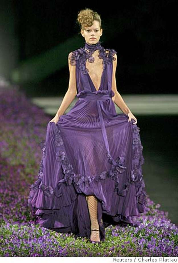 A model presents this creation by Italian designer Stefano Pilati for fashion house Yves Saint Laurent during his Spring/Summer 2007 ready-to-wear collection in Paris October 5, 2006. REUTERS/Charles Platiau (FRANCE) Photo: CHARLES PLATIAU