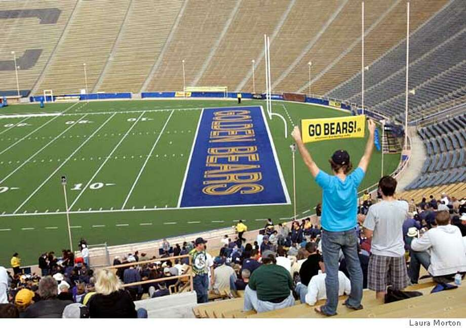 Fans cheered to an empty Cal Memorial Stadium on Saturday while watching the Bears play Washington State University on the scoreboard screen. The game was broadcast at the stadium because it was not being shown on TV. October 14, 2006  Photo by Luara Morton/Special to the Chronicle  Ran on: 10-15-2006  Loyal Cal fans cheered their Bears at a largely empty Memorial Stadium. Cal showed the game on the stadium scoreboard.  Ran on: 10-15-2006  Loyal Cal fans cheered their Bears at a largely empty Memorial Stadium. Cal showed the game on the stadium scoreboard. Photo: Laura Morton