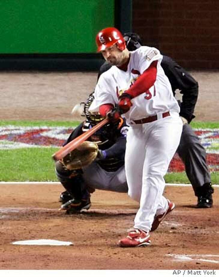 St. Louis Cardinals pitcher Jeff Suppan hits a solo home run during the second inning of Game 3 of the National League Championship Series against the New York Mets, Saturday, Oct. 14, 2006, in St. Louis. (AP Photo/Matt York) Photo: MATT YORK