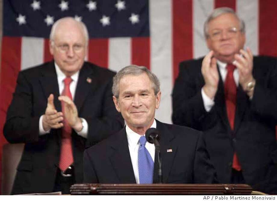 President Bush is applauded as he gives his fifth State of the Union speech Tuesday, Jan. 31, 2006, on Capitol Hill in Washington. Standing behind Bush is House Speaker Dennis Hastert of Illinois, and Vice President Dick Cheney, left,. (AP Photo/Pablo Martinez Monsivais, Pool) Ran on: 02-01-2006  President Bush is welcomed to the Capitol. House Speaker Dennis Hastert (right) and Vice President Dick Cheney stand behind him. Ran on: 02-01-2006  President Bush is welcomed to the Capitol. House Speaker Dennis Hastert (right) and Vice President Dick Cheney stand behind him. Ran on: 02-01-2006  Ran on: 02-01-2006 POOL IMAGE Photo: PABLO MARTINEZ MONSIVAIS