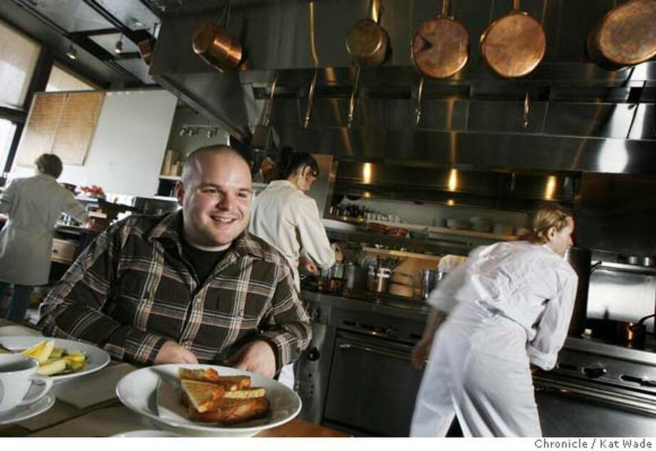 CNO_0046_KW_.jpg  Nate Appleman, (foreground)the executive chef/co-owner of A16 restaurant has breakfast at one of his favorite spots, Boulettes Larder, in the Ferry Building in San Francisco on Thursday September 28, 2006. In the background (L to R) Servers, Katrina Morin and Ivet Karvai and pastry chef, Alison Sullivan are busy at work in the kitchen. Kat Wade/The Chronicle ** Nate Appleman (reporter) Katrina Morin, Ivet Karvai and Alison Sullivan (subjects) cq Mandatory Credit for San Francisco Chronicle and photographer, Kat Wade, Mags out Photo: Kat Wade