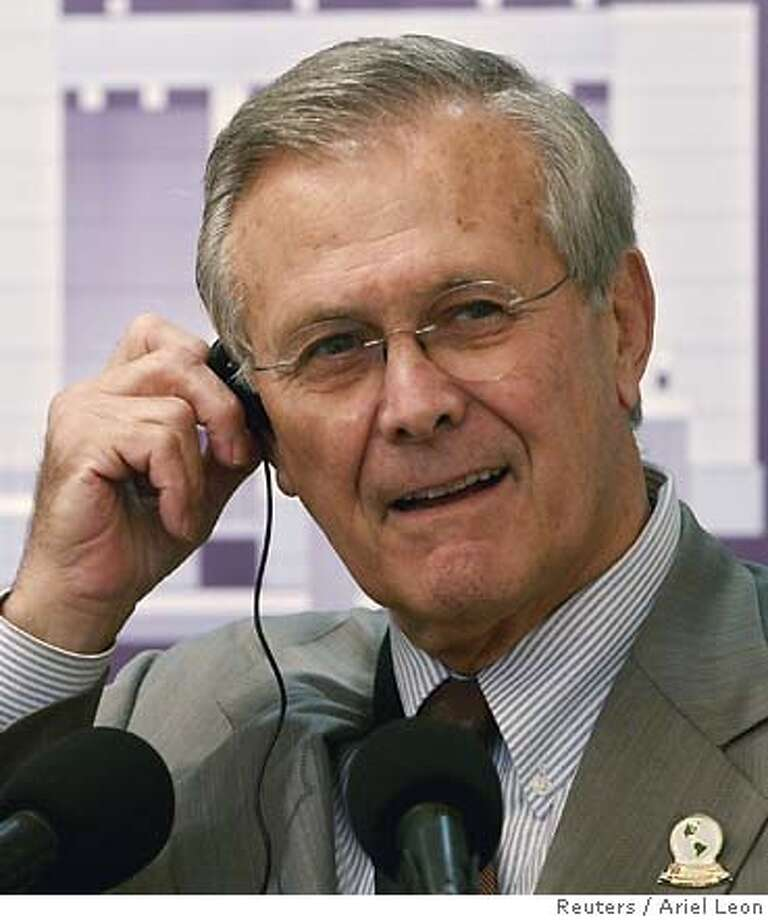 U.S. Secretary of Defense Donald Rumsfeld listens to a question during a news conference at the Presidential House after his meeting with Nicaragua's President Enrique Bolanos in Managua October 3, 2006. REUTERS/Ariel Leon (NICARAGUA) 0 Photo: STR