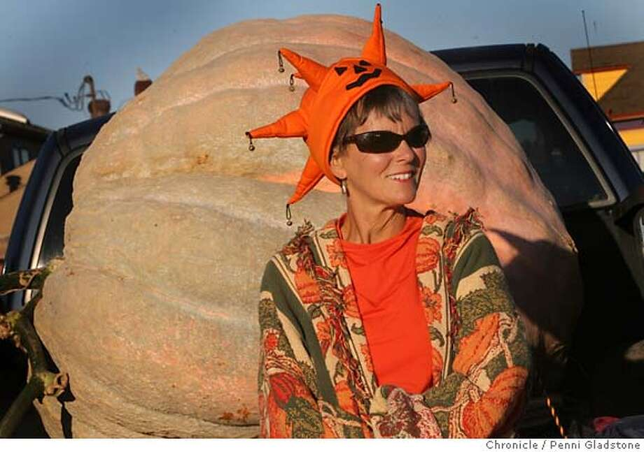PUMPKIN  Cindi Glasier from Napa. She grew this pumpkin which weighs over 1000 lbs. She uses a seaweed based fertilizer. She won in 1991 and has been growing since the 1980's. Shown here at The annual giant pumpkin growing world championships in Half Moon Bay. Event on 10/10/06 in Half Moon Bay.  Penni Gladstone / The Chronicle MANDATORY CREDIT FOR PHOTOG AND SF CHRONICLE/ -MAGS OUT Photo: Penni Gladstone