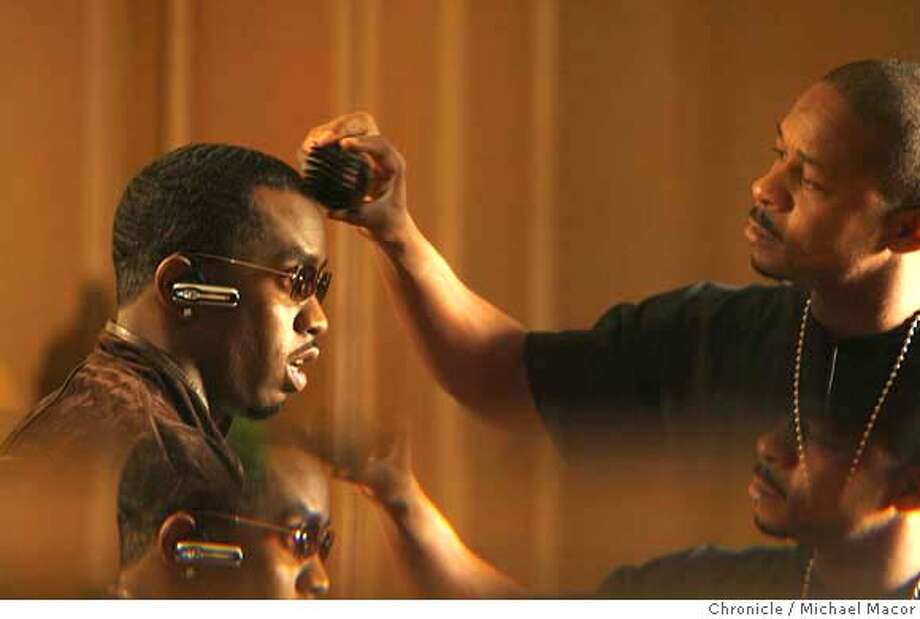 diddy17_025_mac.jpg Diddy gets a final touch up before he does a series of television interviews. (The double image is from shooting through beveled glass). Diddy, in town to promote his first new album in 5 years. Event in, San Francisco, Ca, on 10/12/06. Photo by: Michael Macor/ San Francisco Chronicle Mandatory credit for Photographer and San Francisco Chronicle / Magazines Out Photo: Michael Macor