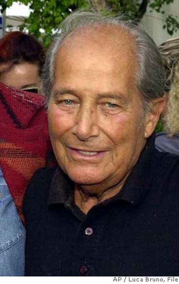 """** FILE **Italian movie director Gillo Pontecorvo is seen at the 58th Venice film festival, at Venice Lido, northern Italy, in this Aug. 30, 2001 file photo. Italian filmmaker Gillo Pontecorvo, who directed the black-and-white classic """"The Battle of Algiers,"""" has died in Rome, hospital officials said Friday. He was 86. (AP Photo/Luca Bruno, file) AUG. 30, 2001 FILE PHOTO Photo: LUCA BRUNO"""
