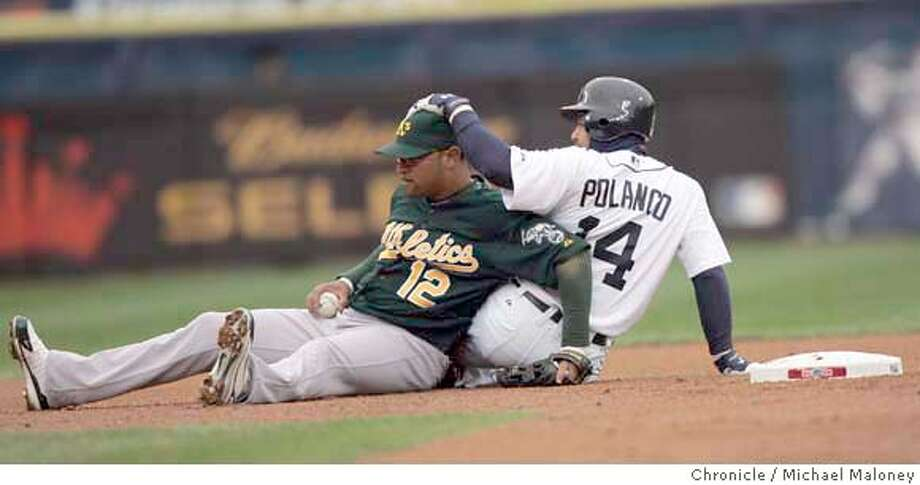 Tigers second baseman Placido Polanco slides into D'Angelo Jimenez to break up a double play in the bottom of the first inning. The Oakland Athletics play the Detroit Tigers in Game 3 of the American League Championship Series. Event on Friday, October 13, 2006 at Comerica Park in Detroit, Michigan. Darryl Bush / The Chronicle Photo: Darryl Bush