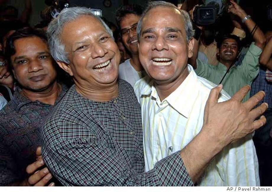 Bangladeshi Nobel Peace Prize winner Muhammad Yunus, left, hugs his younger brother Mohammad Jahangir in Dhaka, Bangladesh, Friday, Oct. 13, 2006. Bangladeshi microcredit pioneer Yunus and his Grameen Bank, or Rural bank, were awarded the Nobel Peace Prize Friday for their work in advancing economic and social opportunities for the poor that has helped millions lift themselves from crushing poverty. (AP Photo/Pavel Rahman) Photo: PAVEL RAHMAN