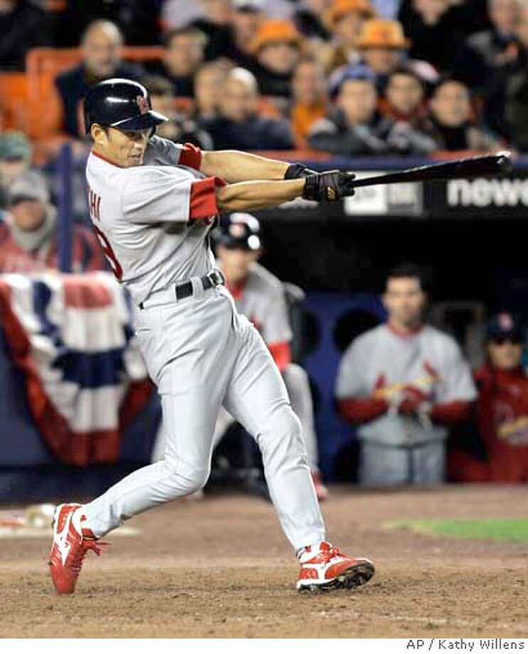 St. Louis Cardinals' So Taguchi hits a solo home run during the ninth inning against the New York Mets in Game 2 of baseball's National League Championship Series, Friday, Oct. 13, 2006, at Shea Stadium in New York. (AP Photo/Kathy Willens) Photo: KATHY WILLENS