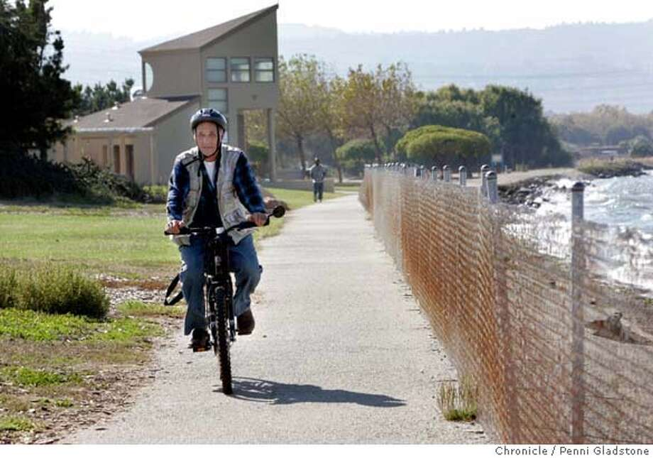 SANMATEOPARKS  Chris Moore of Burlingame rides his bike in Coyote Point Park in San Mateo.  .Event on 10/12/06 in San Mateo.  Penni Gladstone / The Chronicle MANDATORY CREDIT FOR PHOTOG AND SF CHRONICLE/ -MAGS OUT Photo: Penni Gladstone