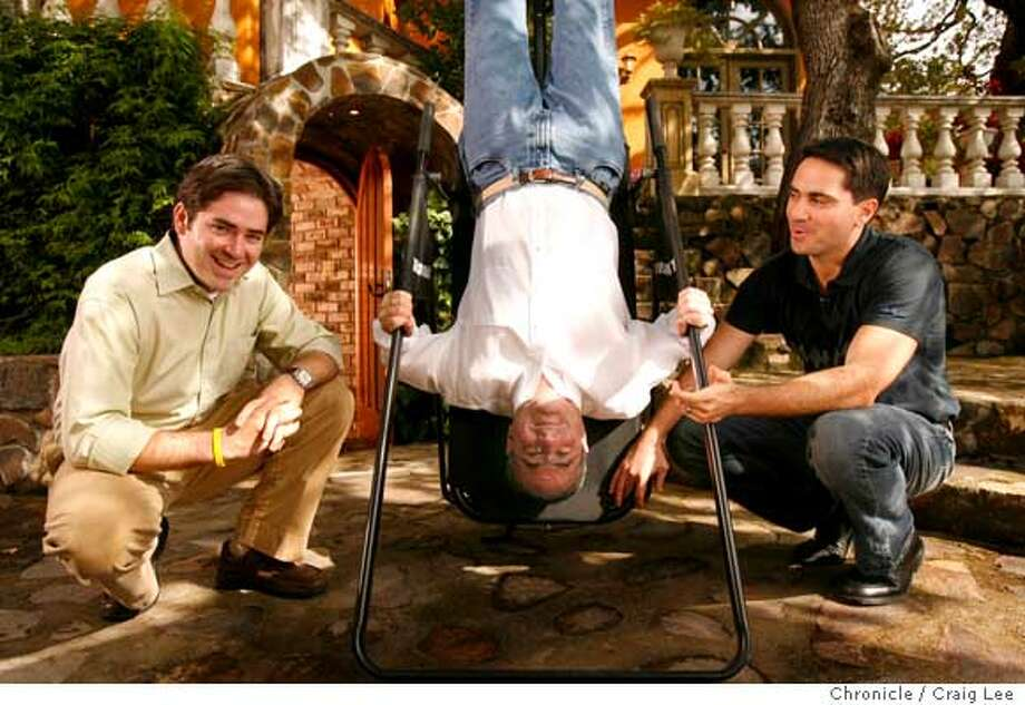 SEBASTIANI13_089_cl.JPG  Profile on Sebastiani and Sons, wine makers from Sonoma. Photo of Don Sebastiani (middle) and his sons, August (left) and Donny (right) at Don Sebastiani's house. Don uses this exercise machine to turn himself upside down and they are also going to be releasing a wine in the near future that has an upside down label.  Craig Lee / The Chronicle  Ran on: 10-08-2006 Ran on: 10-13-2006  Quirky appeal: The Sebastianis think up goofy brand names, like Plungerhead, without using focus groups.  Ran on: 10-13-2006 Photo: Craig Lee