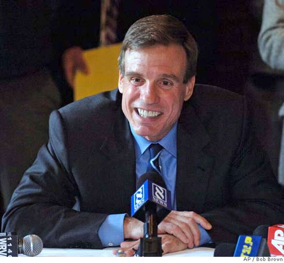Former Virginia Gov. Mark R. Warner announces that he will not run for president in 2008 at a news conference in Richmond, Va., Thursday, Oct. 12, 2006. The Democrat, 51, would not rule out running for the Senate or seeking the governorship again; the state bars incumbents from seeking re-election. (AP Photo/Richmond Times-Dispatch, Bob Brown) Photo: BOB BROWN