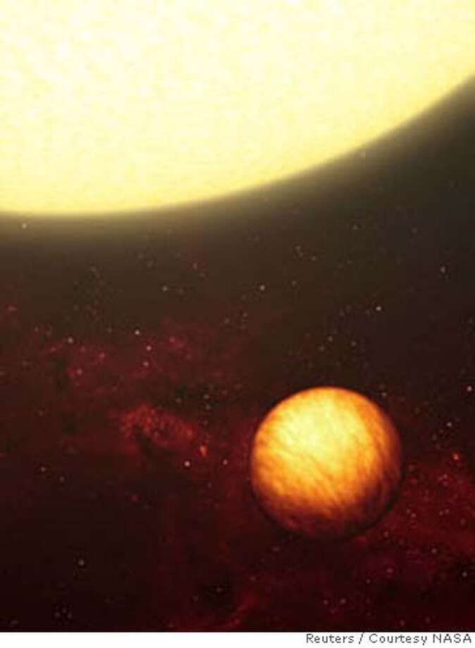 This artist's concept shows a Jupiter-like planet soaking up the scorching rays of its nearby star. A similar gas-giant planet, called Upsilon Andromeda b, has one face that is perpetually cold and dark, and another that forever blisters under the heat of its star. According to astronomers who studied the planet using NASA's Spitzer Space Telescope, the side of the planet facing the star is as hot as lava (between 2,550 and 3,000 degrees F), while the other side is as cold as ice (between minus 4 and 450 degrees F). The researchers believe the atmosphere of the planet absorbs and re-radiates light so fast that heated gases circulating around the planet cool off before reaching the dark side. FOR EDITORIAL USE ONLY REUTERS/Courtesy NASA/JPL-Caltech/Handout (UNITED STATES) Photo: HO