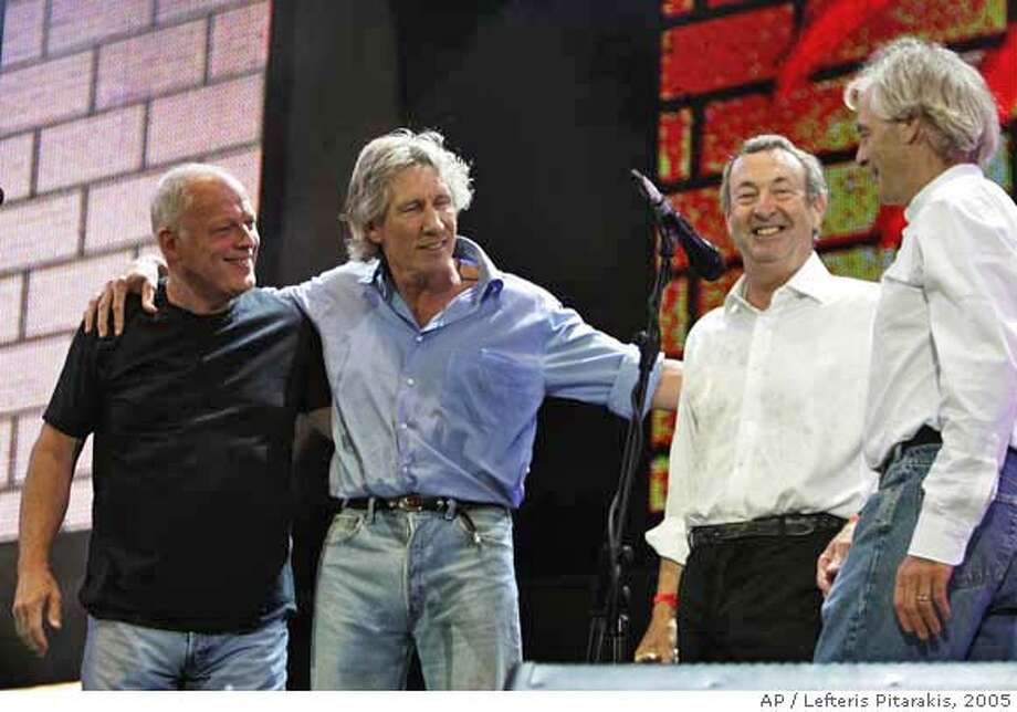 Pink Floyd's Dave Gilmore, left, Roger Waters, second left, Nick Mason, second right, and Rick Wright, at the end of their set at the Live 8 concert in Hyde Park, London, Saturday July 2, 2005. The concert is part of a series of free concerts being held around the world designed to press leaders of the rich G8 countries to help impoverished African nations. (AP Photo/Lefteris Pitarakis) Photo: LEFTERIS PITARAKIS