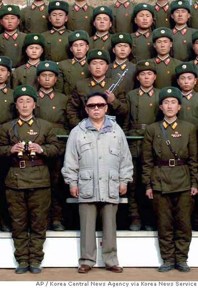 North Korean leader Kim Jong Il, center, poses for a photograph with the soldiers of Korean People's Army 821 unit, at an undisclosed area in North Korea, in this early April 2006 photo. (AP Photo/Korea Central News Agency via Korea News Service ) ** JAPAN OUT, ** JAPAN OUT, Photo: Korea Central News Agency