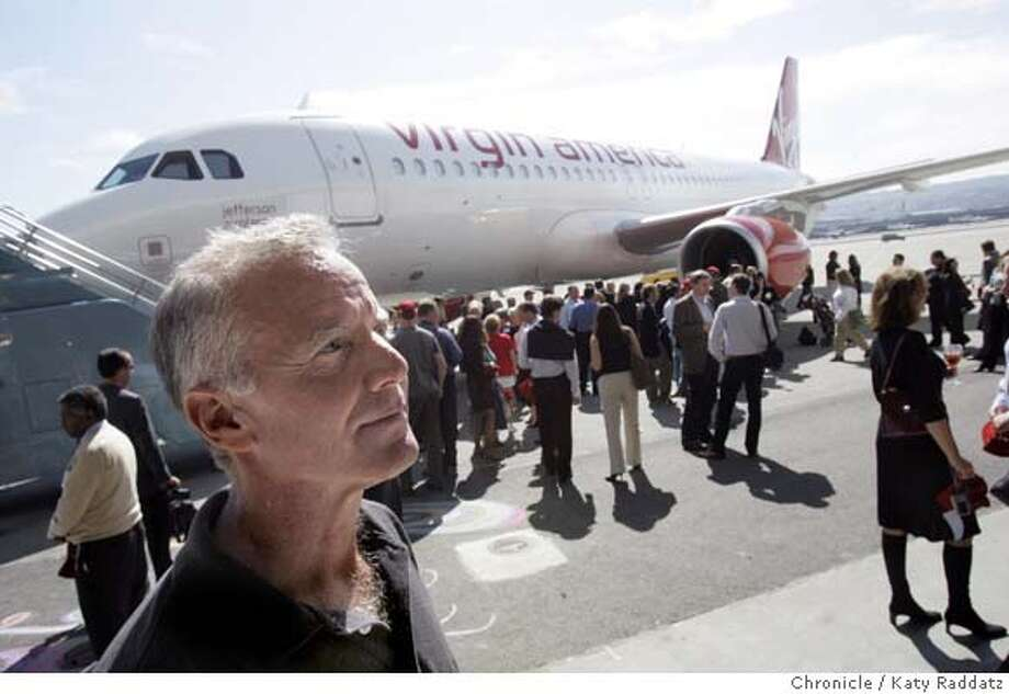 "VIRGIN12_046_RAD.jpg  SHOWN: Fred Reid, CEO of Virgin America, with the ""Jefferson Airplane"" aircraft in the background. The would-be, San Francisco-based airline, Virgin America, takes possession of its first airline, called ""Jefferson Airplane"" in honor of Grace Slick and the Jefferson Airplane. These photos were made on Wednesday, Oct. 11, 2006, at SFO, CA. (Katy Raddatz/The S.F.Chronicle)  **Fred Reid Mandatory credit for photographer and the San Francisco Chronicle/ -Mags out Photo: Katy Raddatz"